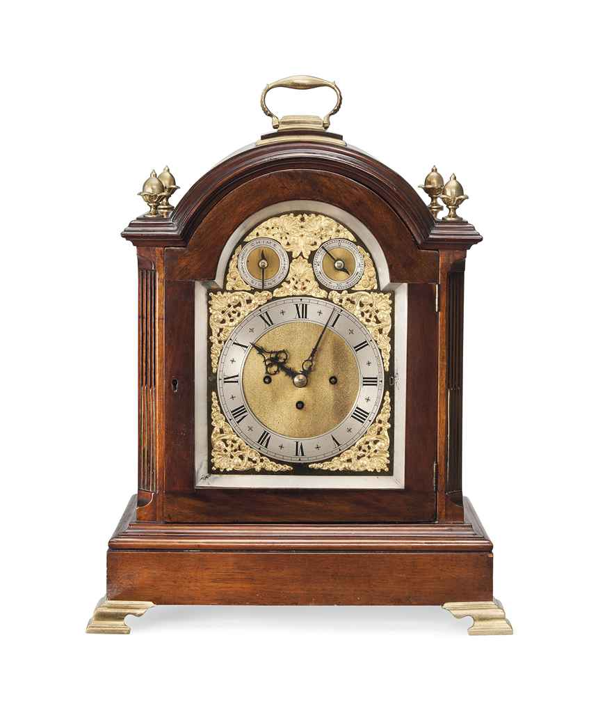 AN EDWARDIAN BRASS-MOUNTED MAHOGANY CHIMING DIRECTORS' CLOCK...