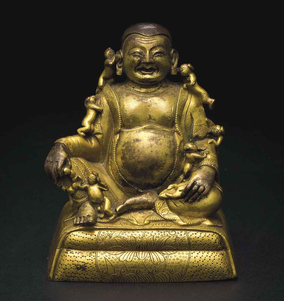 A gilt bronze figure of Budai