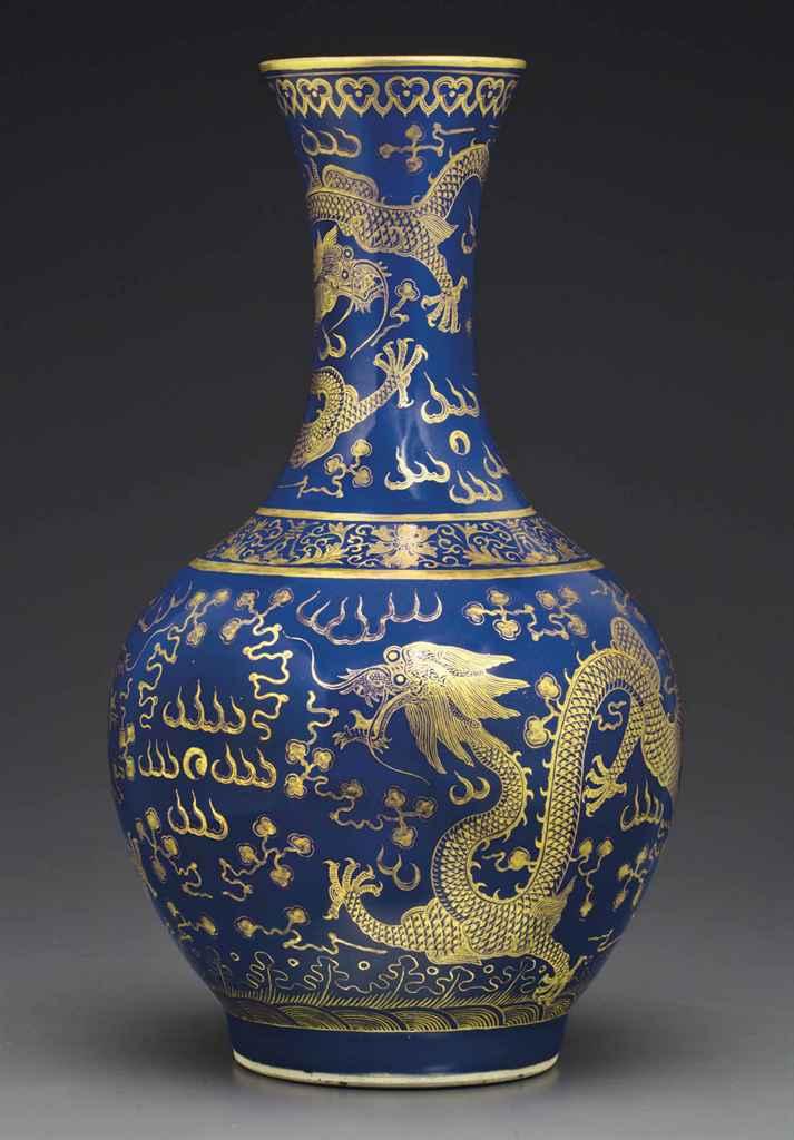 A GILT-DECORATED BLUE-GROUND BOTTLE VASE