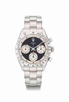 Rolex. An extremely rare and historically important stainless steel chronograph wristwatch with black dial and bracelet