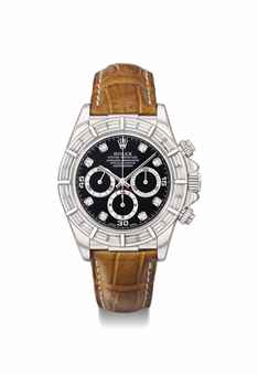 Rolex. A very rare and attractive 18K white gold and diamond-set automatic chronograph wristwatch