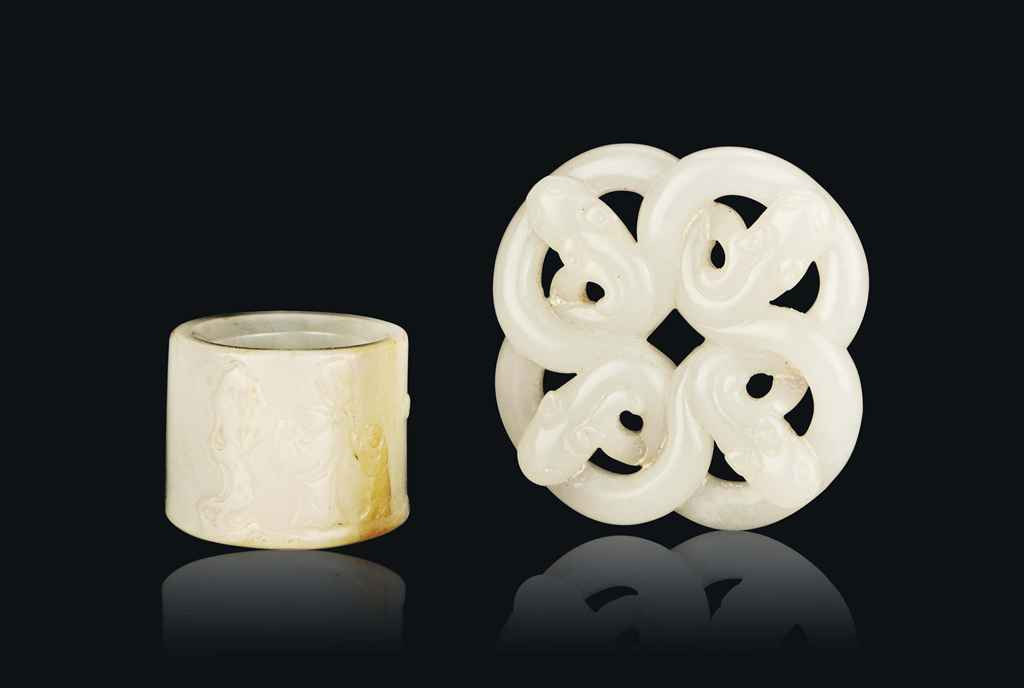 A WHITE JADE CARVING AND A WHITE JADE ARCHER'S RING