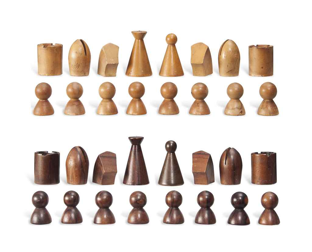 a walnut and beech chess set  by man ray ()   - a walnut and beech chess set