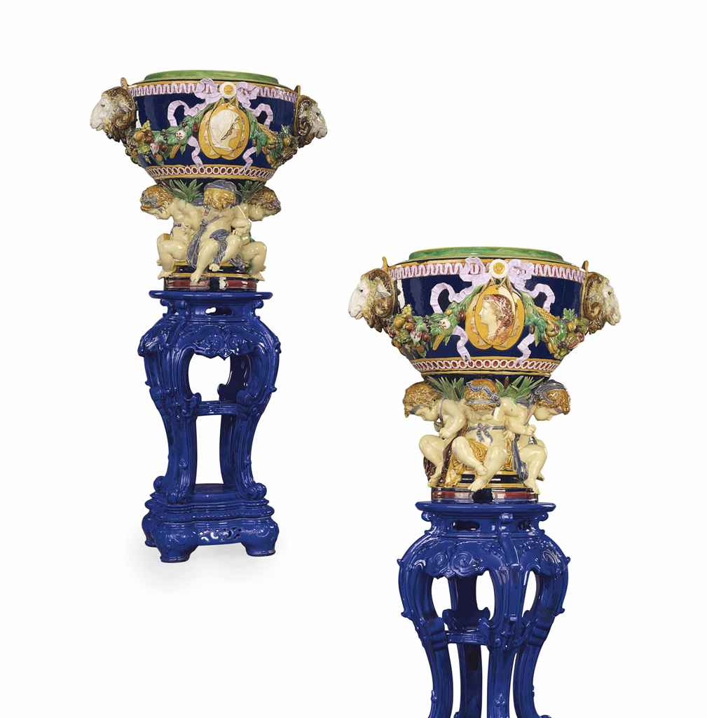 A LARGE PAIR OF MINTONS MAJOLICA JARDINIERES AND A PAIR OF P...