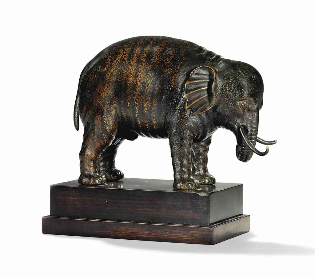 A BRONZE MODEL OF AN ELEPHANT,