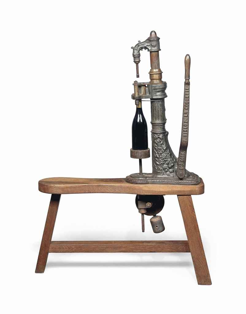A FRENCH CAST-IRON WINE CORKIN