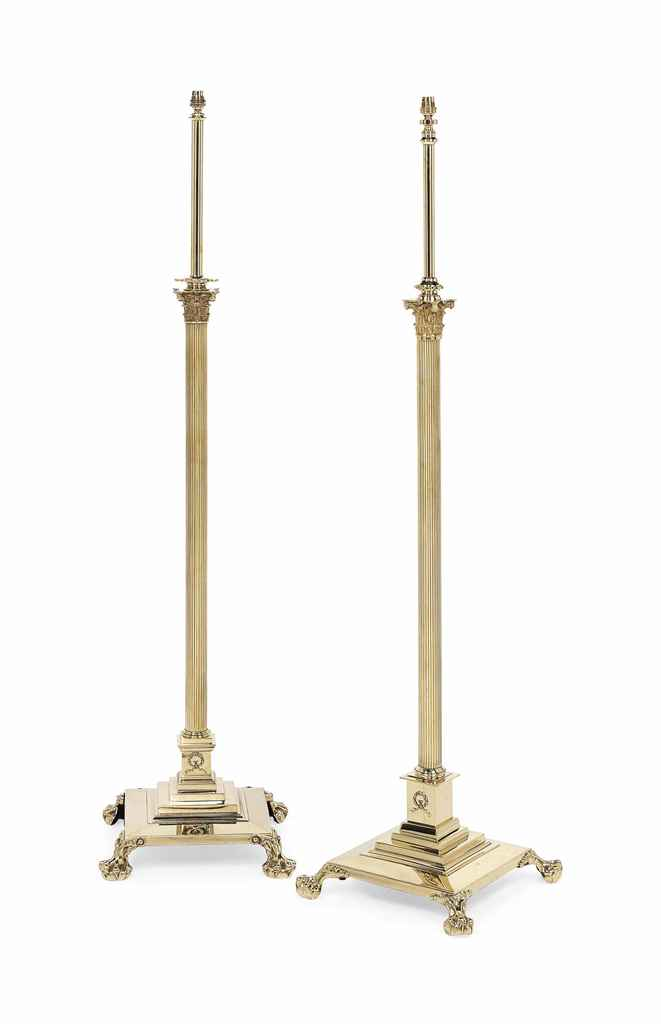 A PAIR OF ENGLISH BRASS STANDA