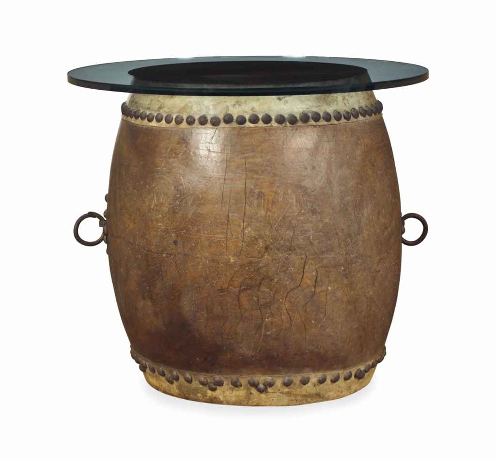 A JAPANESE WOOD DRUM WITH CAST