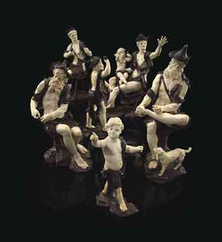 A GROUP OF SIX CARVED IVORY AND WALNUT FIGURES OF BEGGARS