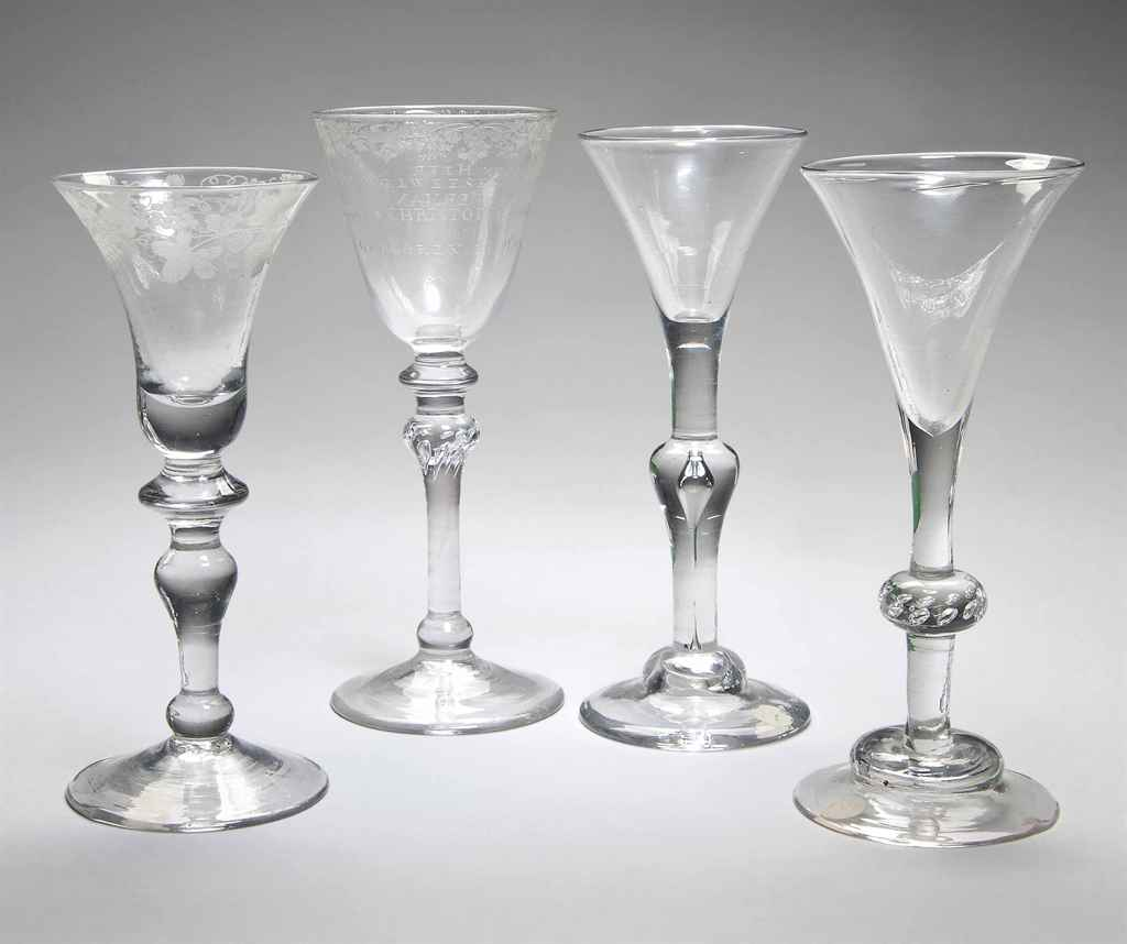 A DUTCH-ENGRAVED AND DATED LIGHT-BALUSTER WINE GLASS AND THR...