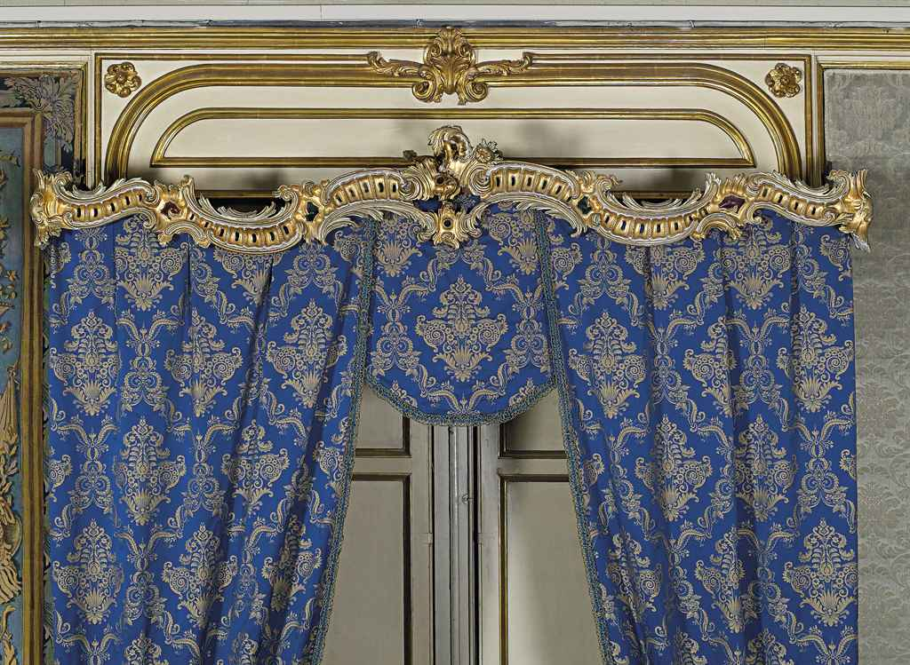 A SET OF THREE ITALIAN GILTWOOD AND WHITE-PAINTED CURTAIN RA...