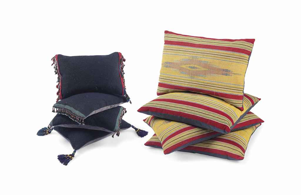 A SET OF FOUR ANATOLIAN WOOL CUSHIONS AND A SET OF FOUR ALEP...