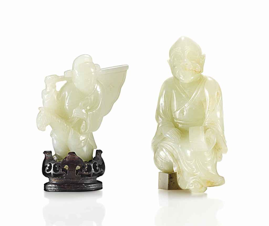 A WHITE JADE CARVING OF A BOY ON A HOBBY HORSE, AND ANOTHER ...