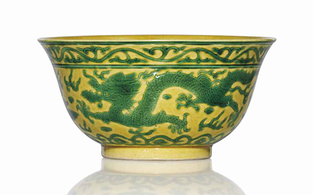 A GREEN AND YELLOW GLAZED 'DRA