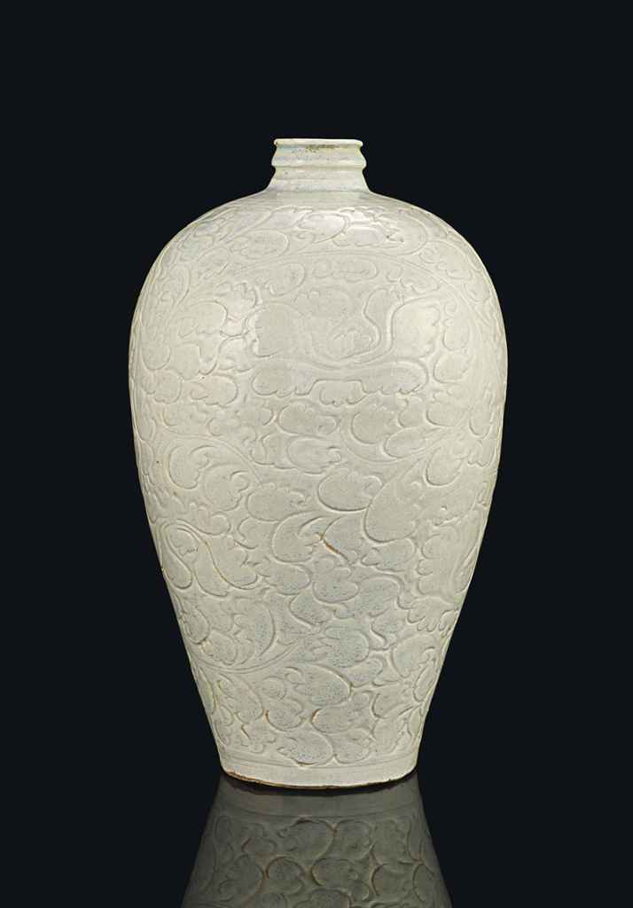 A QINGBAI CARVED MEIPING
