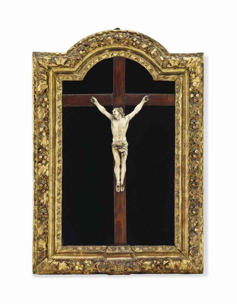 A FRENCH IVORY CRUCIFIX SET IN