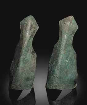 A PAIR OF GREEK BRONZE ANKLE GUARDS