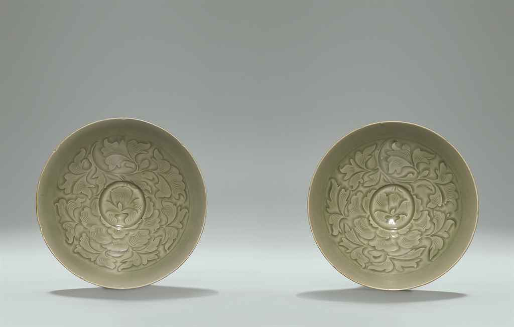 TWO RARE AND SUPERBLY CARVED YAOZHOU CELADON SHALLOW BOWLS ...