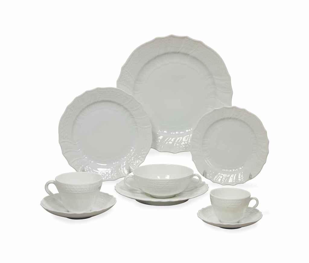 A GERMAN WHITE-GLAZED PORCELAIN DINNER SERVICE