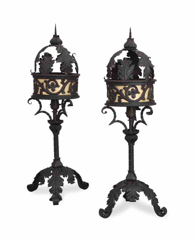a pair of black painted wrought iron and metal table lamps. Black Bedroom Furniture Sets. Home Design Ideas