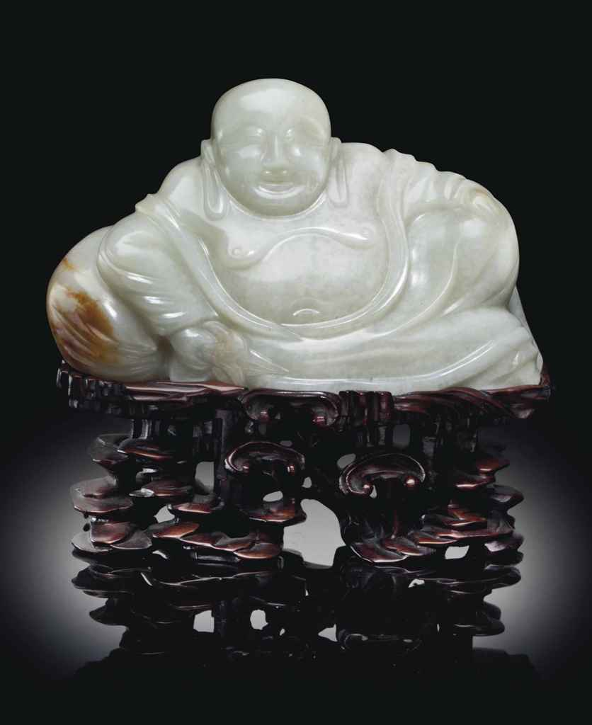A WHITE JADE FIGURE OF RECLINING BUDAI