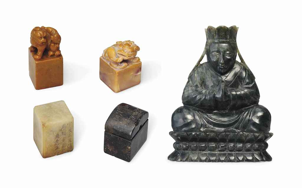 A SPINACH-GREEN JADE FIGURE OF BUDDHA, AND FOUR SEALS