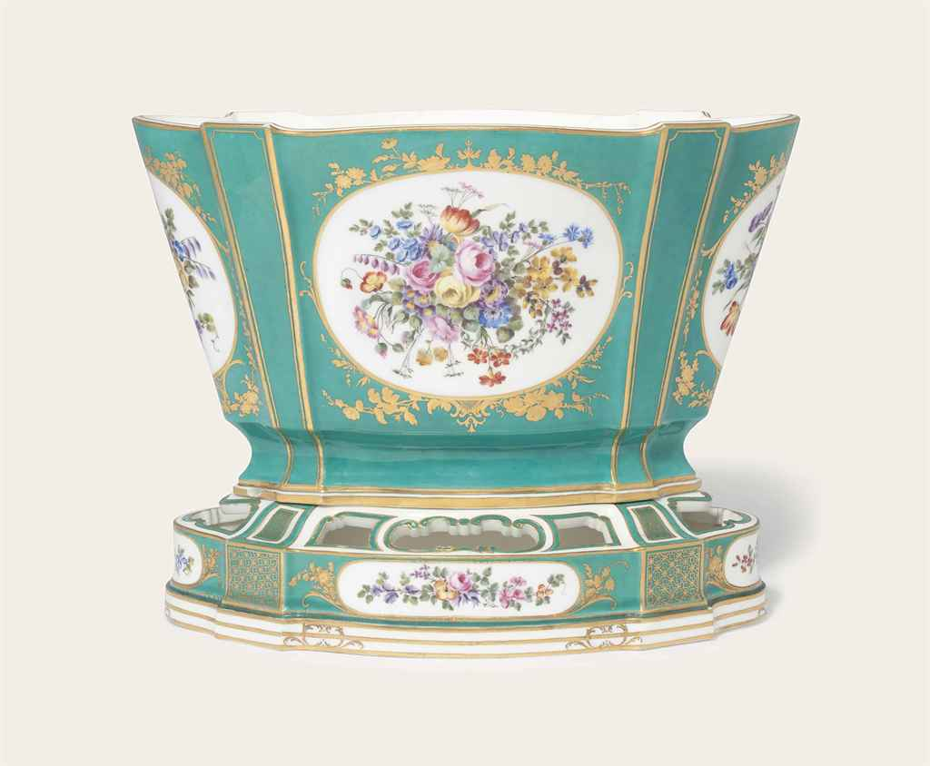 A SEVRES GREEN-GROUND OVAL FLOWER-VASE AND STAND (VASE 'HOLL...