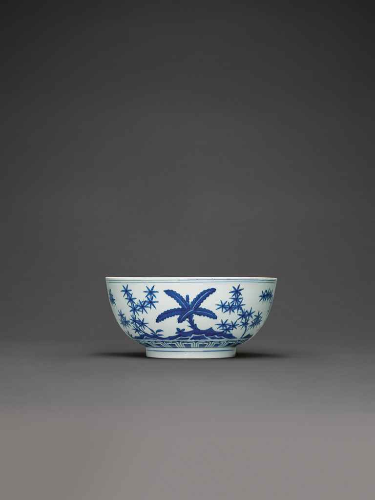 A RARE BLUE AND WHITE 'BAMBOO AND PLANTAIN' BOWL