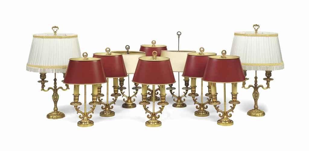 A SET OF EIGHT MODERN GILT-BRASS TWO-BRANCH CANDELABRA LAMPS...