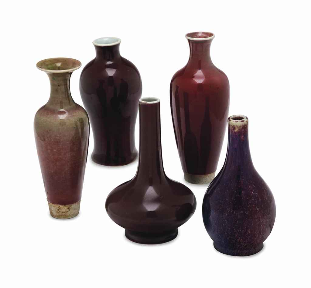 A GROUP OF MONOCHROME-GLAZED VASES, AND A FLAMBE GLAZED MALL...