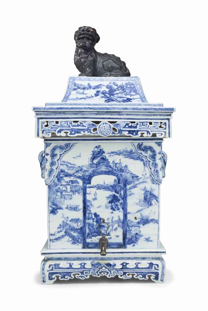 A BLUE AND WHITE CISTERN AND C
