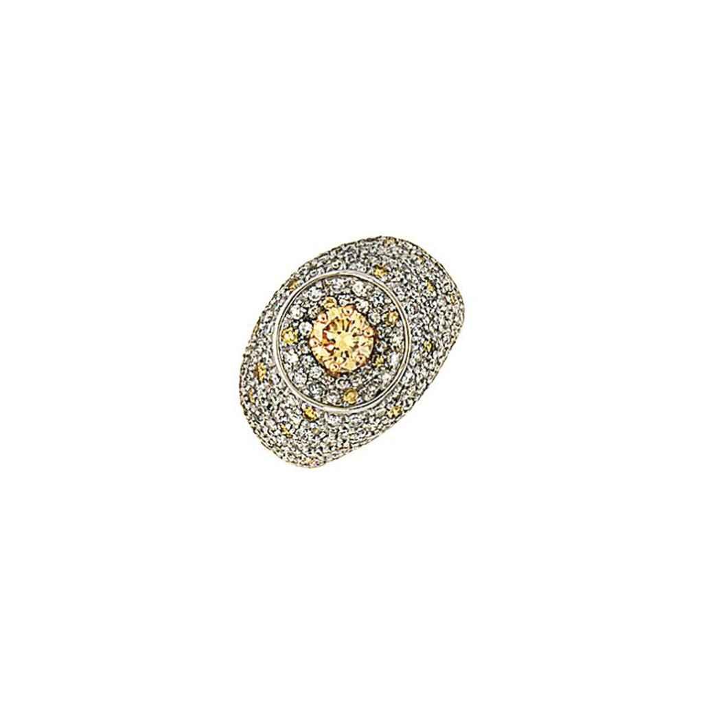 A coloured diamond and diamond dress ring