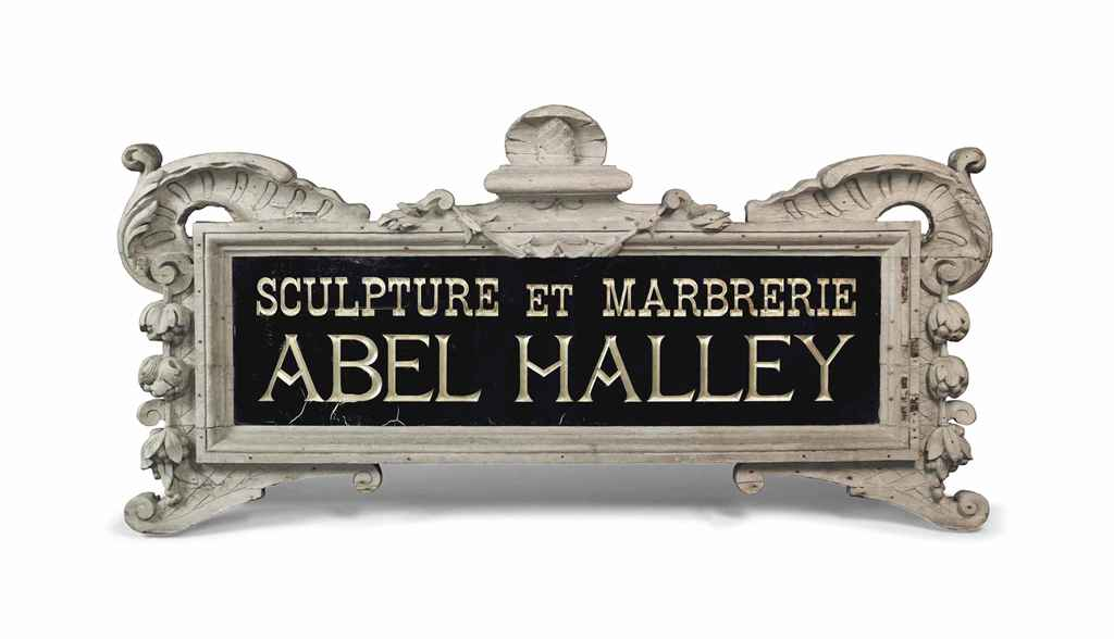 A FRENCH GLASS SHOP SIGN IN A