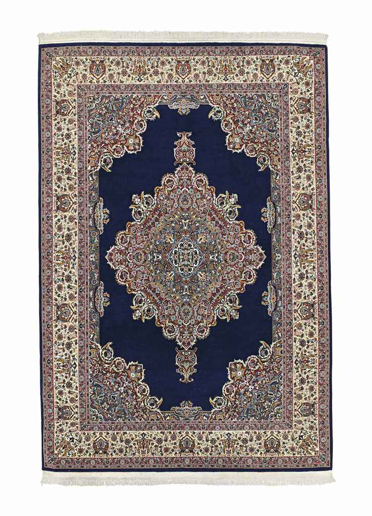 An extremely fine part silk Indo-Tabriz carpet