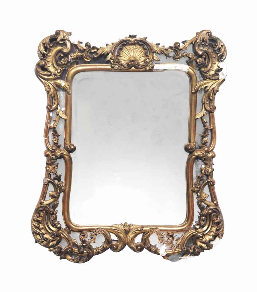 A GILTWOOD AND PLASTER MIRROR,