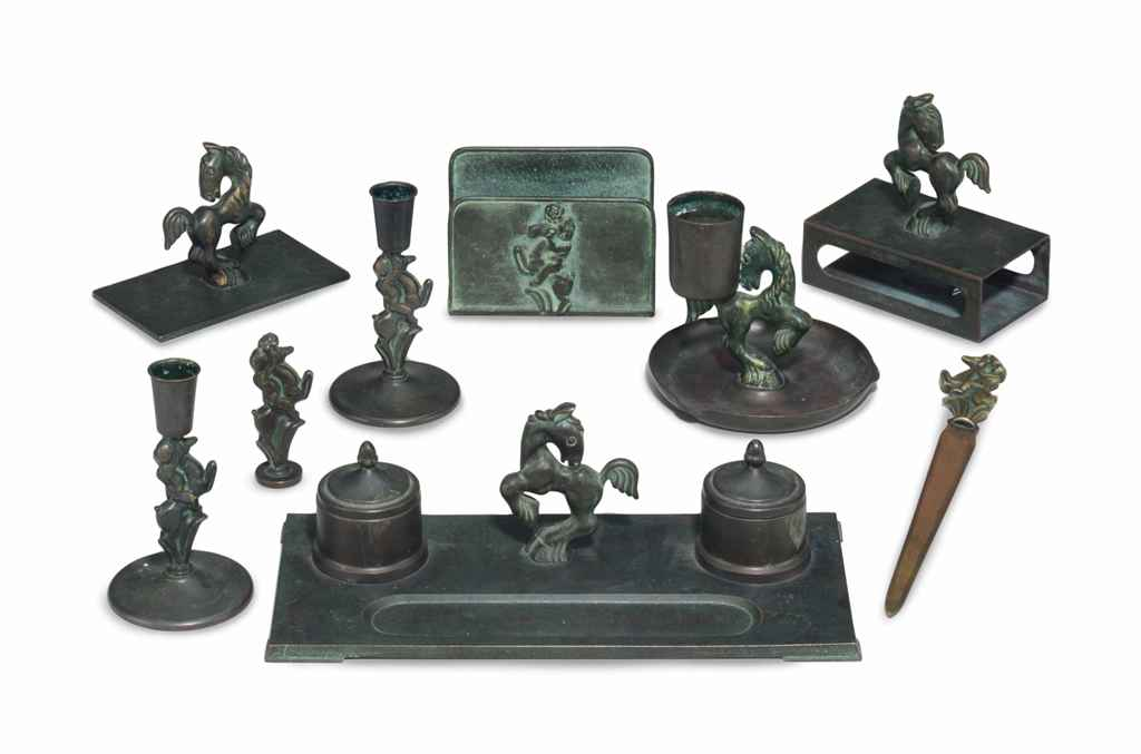 A PATINATED BRONZE DESK SET,