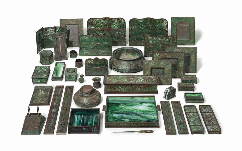 AN AMERICAN BRONZE AND FAVRILE GLASS EXTENSIVE DESK SET IN T...