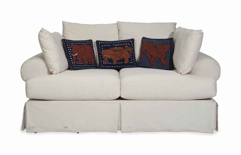 A MODERN TWO-SEAT SOFA COVERED