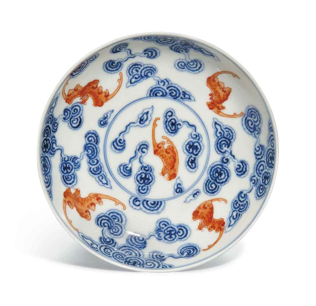 A CHINESE UNDERGLAZE BLUE AND IRON RED DECORATED 'BAT' DISH ...