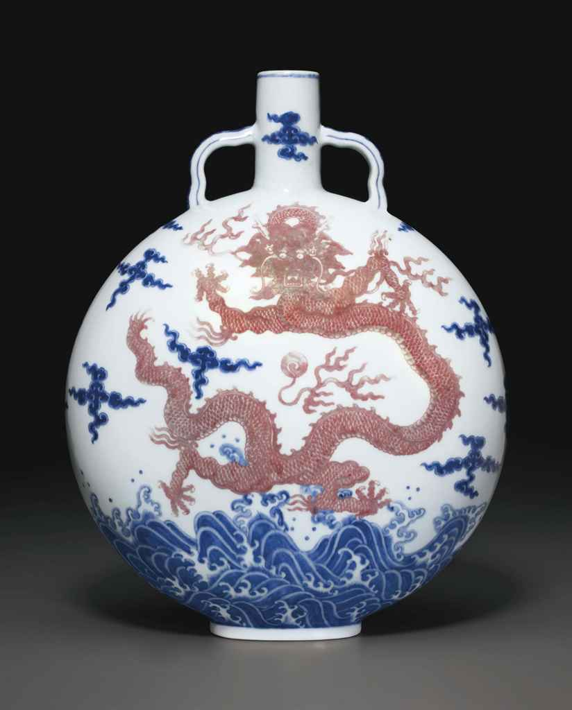 AN UNDERGLAZE-BLUE AND COPPER-RED-DECORATED 'DRAGON' MOONFLA...