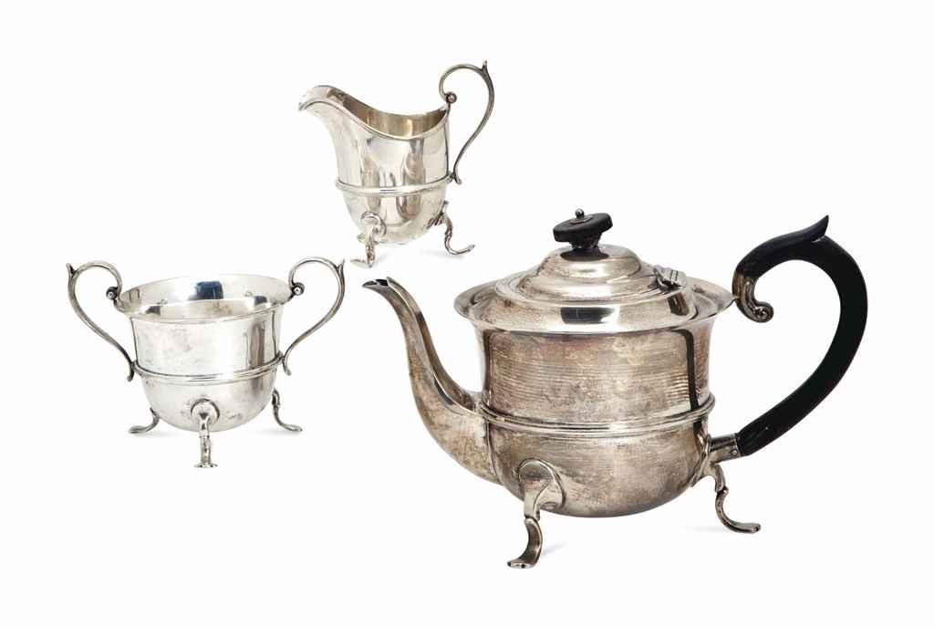 A VICTORIAN SILVER THREE-PIECE TEA SET