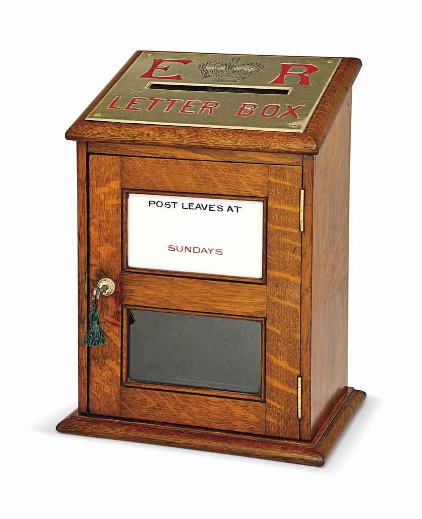 AN EDWARDIAN OAK POST-BOX