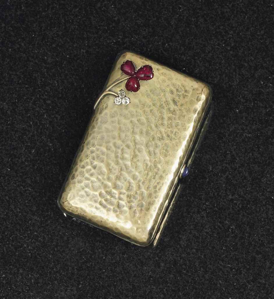 A JEWELED GOLD CIGARETTE CASE