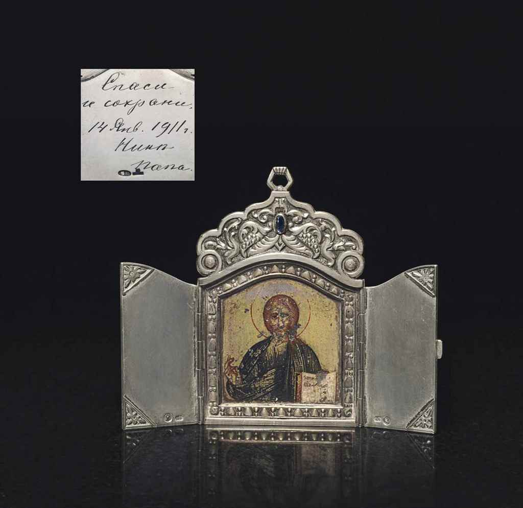 A SILVER-GILT TRIPTYCH ICON OF