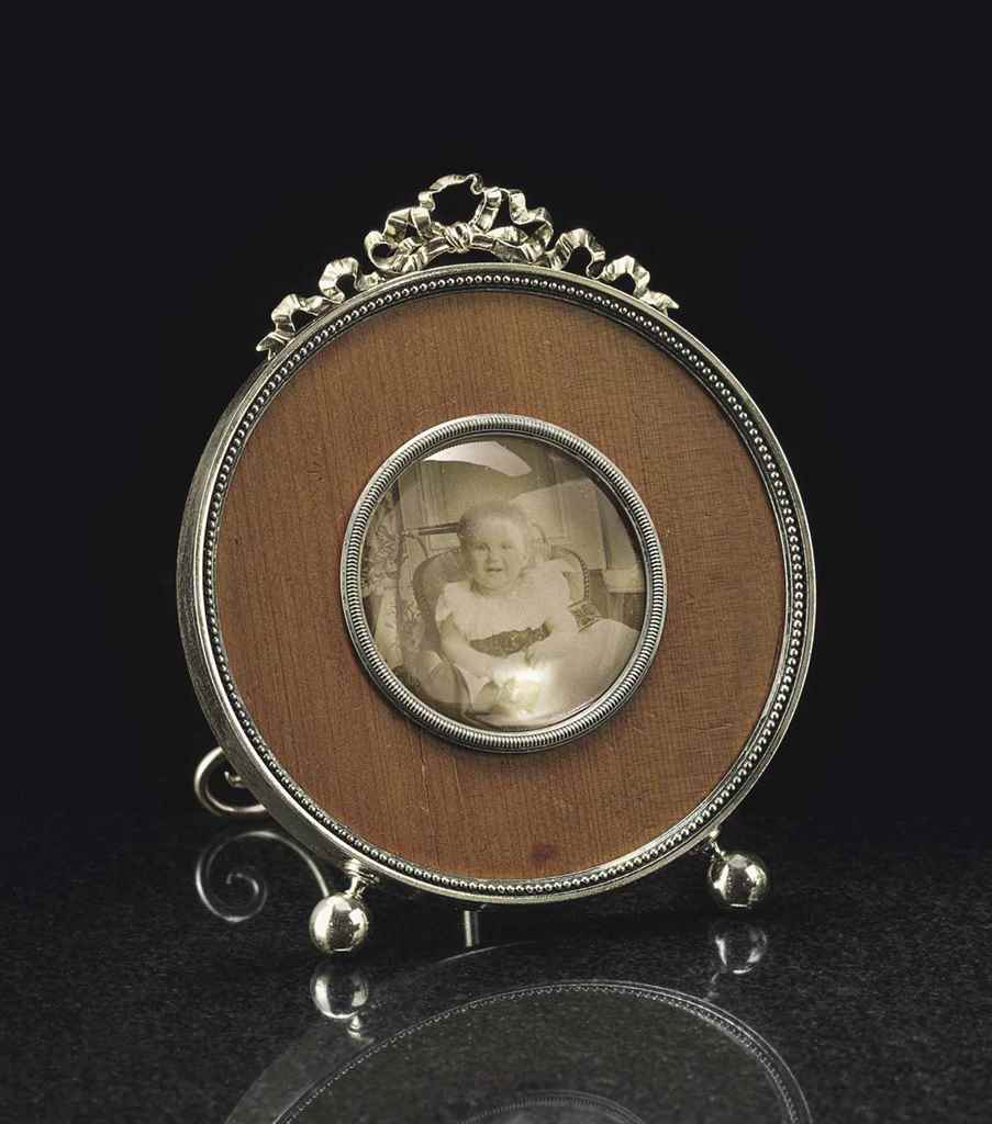 A SILVER-MOUNTED WOOD PHOTOGRA