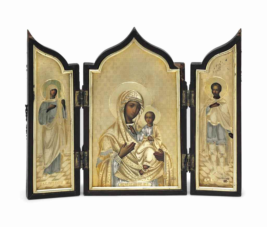 A PARCEL-GILT TRIPTYCH ICON OF
