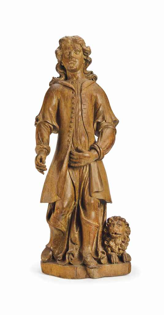 A CONTINENTAL CARVED OAK FIGUR