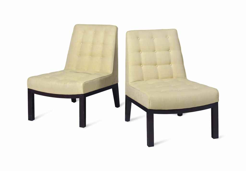 A MODERN PAIR OF BUTTON-TUFTED