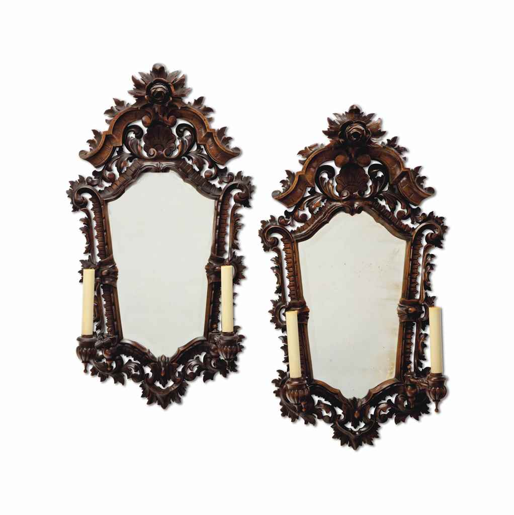 A PAIR OF CARVED WALNUT MIRROR