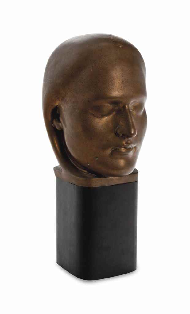A PATINATED BRONZE HEAD OF A W